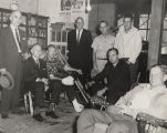 John Patterson with a group of men, possibly in the back of a general store.