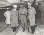 Governor John Patterson and Congressman Tom Bevill visiting a mine in Alabama.
