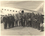 Frank W. Boykin and a group men standing in front of a U.S. Navy plane.