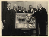 Frank W. Boykin and group with an International Paper Company display board.