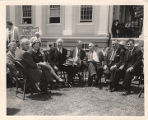 Frank W. Boykin and others sitting on the lawn of the Warrenton Courthouse in Fauquier County,...