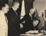 President Kennedy signs a bill (S. 900) at the White House, April 24, 1961, to provide for the...