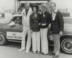 Bill France, Sr., Cornelia Wallace, and others in front of Governor George Wallace's car at a...