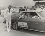 George Wallace being interviewed by Bill France, Sr., during a Winston Cup race in Talladega,...