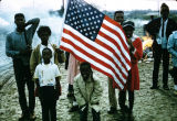 African American children with an American flag, probably during the Selma to Montgomery March.