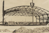 Construction of a steel hangar at Bates Field in Mobile, Alabama.