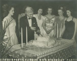Noble Seay cutting a cake at the fourth anniversary celebration of the USO Soldiers Center in...