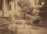 Saffold Joseph as a young boy in a goat-drawn cart in front of Dr. W. C. Jackson's old house on...