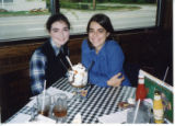 Sisters Rachel and Mary Catherine Eddins eating lunch in Mobile, 1998.